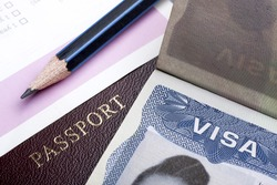 Passport and US visa background with  immigration application form.
