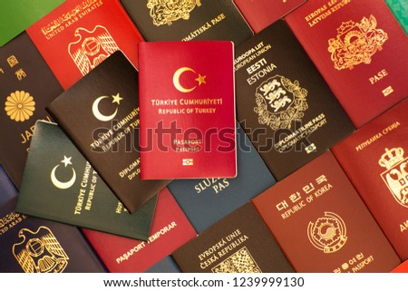 Passport, special passport, diplomatic passport of the Republic of Turkey against the background of various passports of many countries of the world