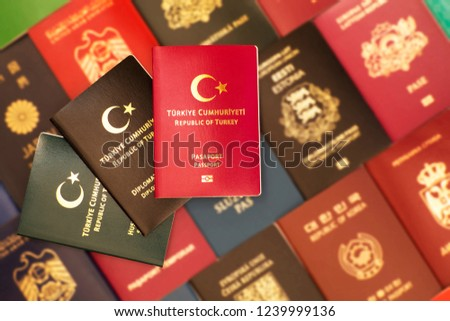 Passport, special passport, diplomatic passport of the Republic of Turkey on a blurred background of various passports of many countries of the world