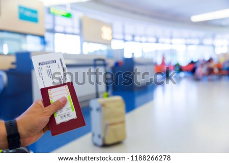 Passport with boarding pass at departure terminal gate in airport