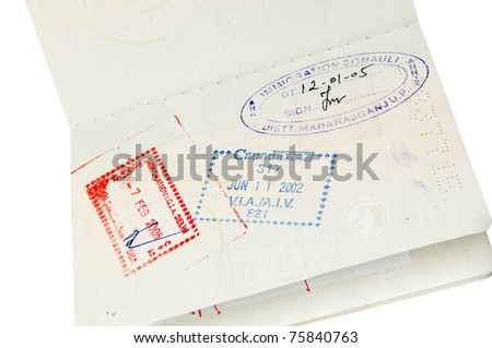 Passport with multiple stamps isolated over white
