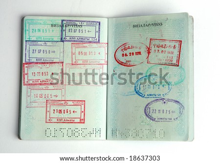 Passports and lot of stamps on it.