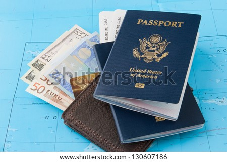 Passports and wallet with dollars, euro and credit card on a map background. Travel concept.