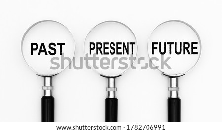 Past present and future text under magnifying lenses Сток-фото ©