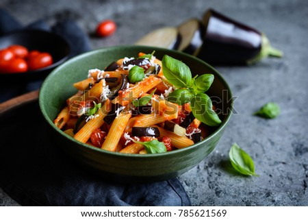 Pasta alla Norma - traditional Italian food with eggplant, tomato, cheese and basil