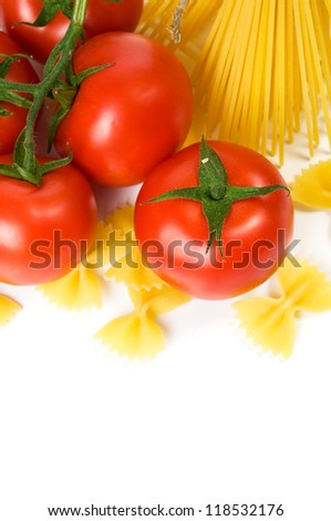 Pasta and tomatoes on the white with copy space
