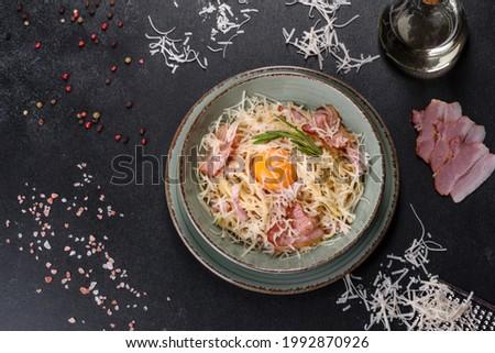 Pasta Carbonara. Spaghetti with bacon, egg, parsley and Parmesan cheese. A traditional Italian dish