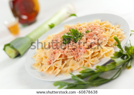 Pasta Farfalle with smoked Salmon, fresh cream, leeks and brandy