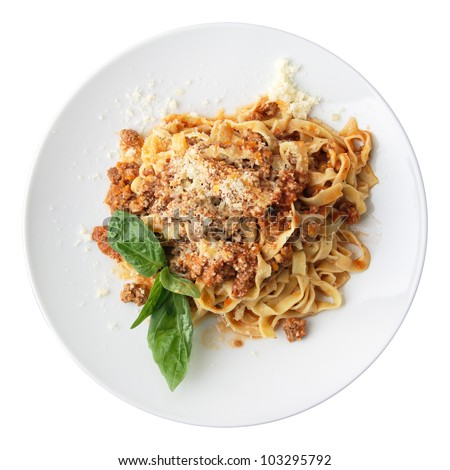 Pasta fettuccine Bolognese with leaf of basil on a white round dish isolated over white background. Top view. - stock photo
