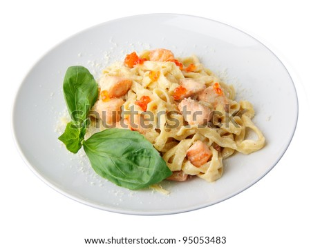 Pasta fettuccine with salmon and caviar on a white dish isolated on a white background.