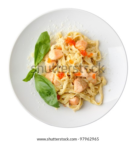 Pasta fettuccine with salmon and caviar on a white dish isolated on a white background. Top view. #97962965