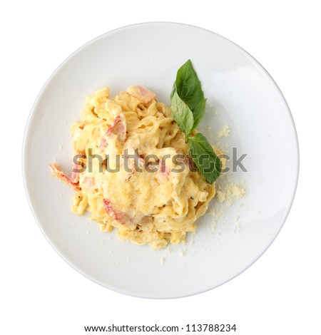 Pasta fettuccini carbonara with ham and cheese on a white dish isolated on a white background. Top view. - stock photo