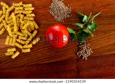 Pasta, ingredients, tomatoes, spices and basil. Pasta Ingredients
