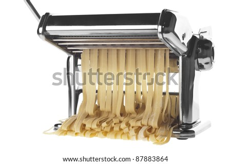 Pasta machine with fresh noodles over white