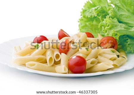 pasta on white plate with cherry tomatoes and lettuce 	 leaf on white background