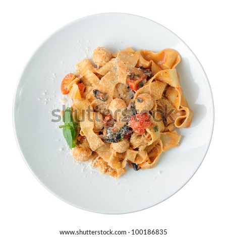 Pasta pappardelle with chicken noisettes and parmesan on white dish isolated on a white background. Top view.