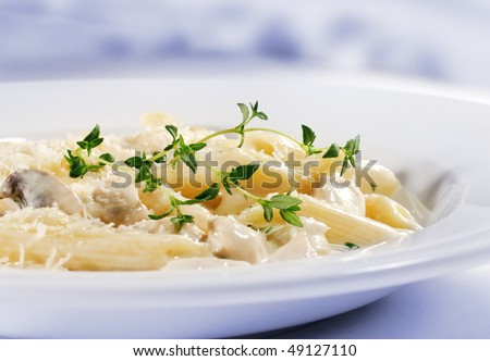 Pasta Penne with Chicken and Mushroom under Parmesan Cheese