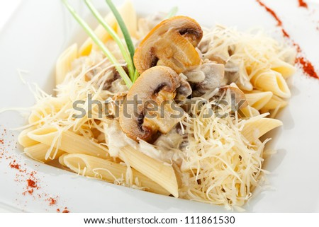 Pasta Penne with Mushrooms and Parmesan Cheese. Garnished with Lettuce