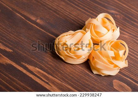 pasta raw three circles on a brown wooden table