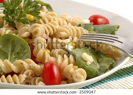 Pasta salad made with a variety of fresh garden vegetables.