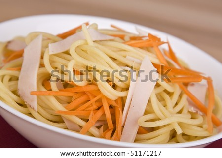 Pasta salad with carrot and meat