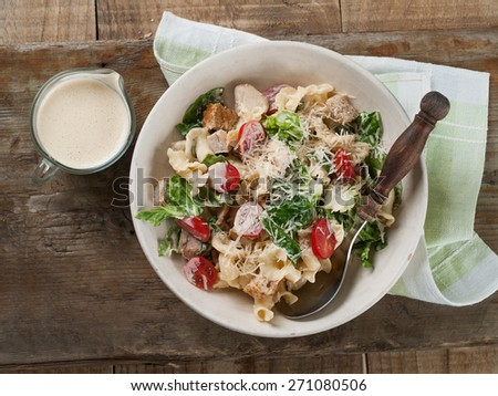 Pasta salad with chicken, tomato, cheese and sauce, selective focus #271080506