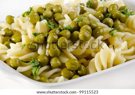 pasta salad with organic peas - stock photo