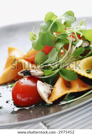 pasta salad with tomato,rocca,mushrooms,herbs - stock photo
