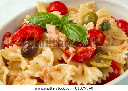 pasta salad with tomatoes,tuna and olives