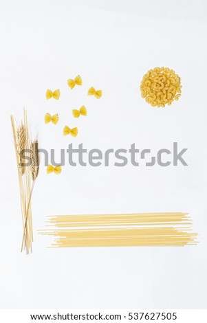 Pasta,  spaghetti and wheat on a white background. Bright and cheerful picture.