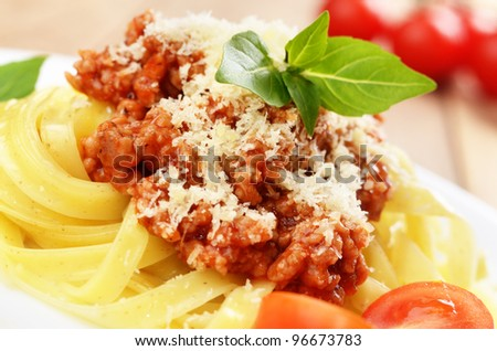 Pasta tagliatelle with beef bolognese sauce and parmesan