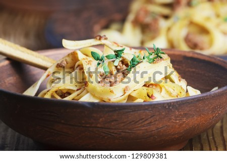 pasta tagliatelle with bolgnese sauce on the wooden table