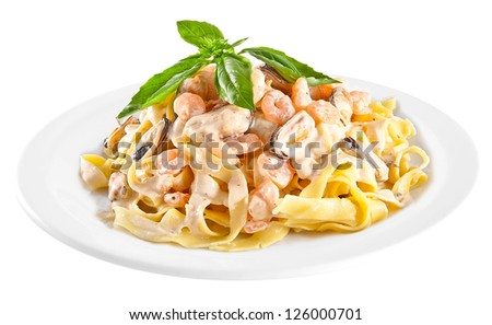 Pasta tagliatelle with seafood isolated on white background