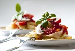 Pasta tagliatelle with tomato sauce and mushrooms
