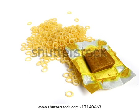 Pasta to Soup with a block of a  dehydrated flavor on a white background