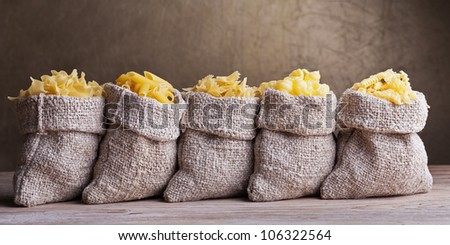 Pasta variety in small burlap sacks in a row