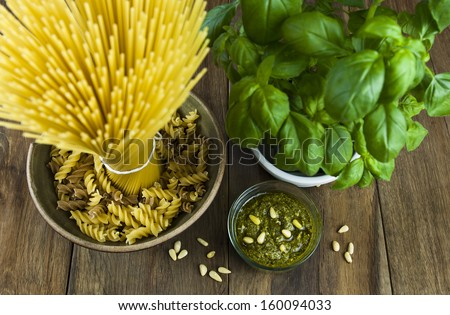 Pasta with basil pesto, pine nuts, basil bunch