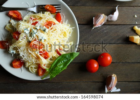 pasta with cheese and tomatoes, top view, food