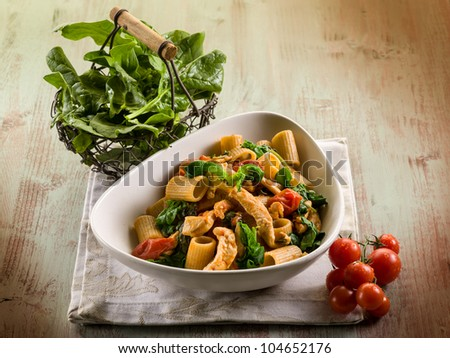 pasta with chicken  spinach and tomatoes - stock photo