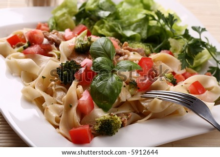 Pasta with meat and vegetable salad