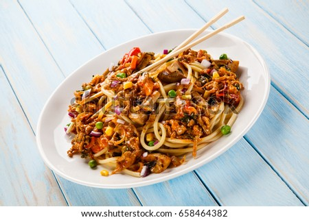 Pasta with meat asian style on white background