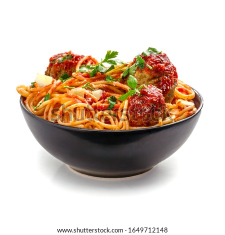 Pasta with meatballs, parmesan and tomato sauce in a clay bowl. Homemade Italian spaghetti isolated on white background.