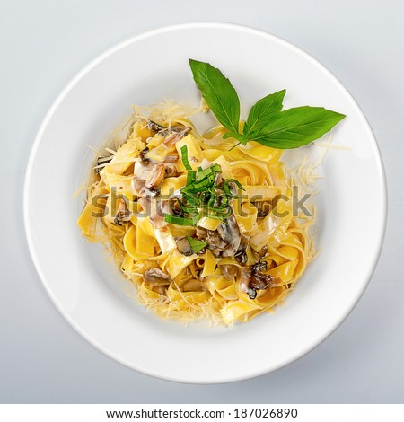 Pasta with mushrooms and cheese top view