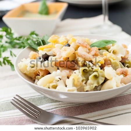 pasta with pesto italian basil sauce and prawns