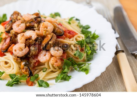 pasta with seafoods and white wine on napkins