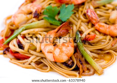 pasta with shrimps and asparagus, seasoned with tomato sauce