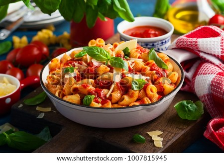 Pasta with spicy tomato sauce, parmesan and basil. Pasta Chifferi Rigati.