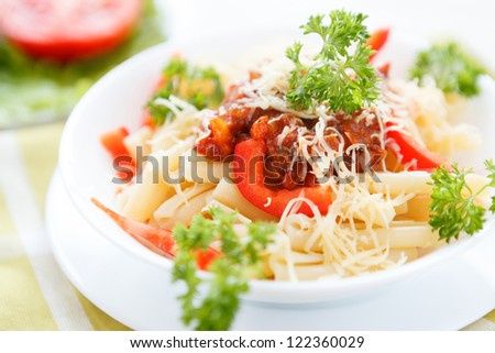 pasta with tomato sauce and paprika, close-up