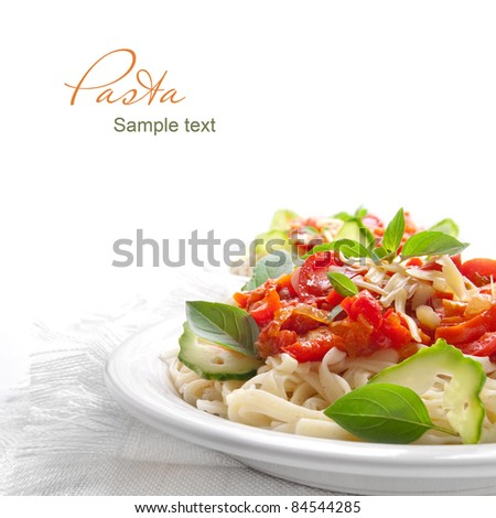 Pasta with tomato sauce basil and grated parmesan