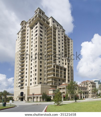 pastel beige luxury condos with tropical landscaping in Jacksonville, Florida